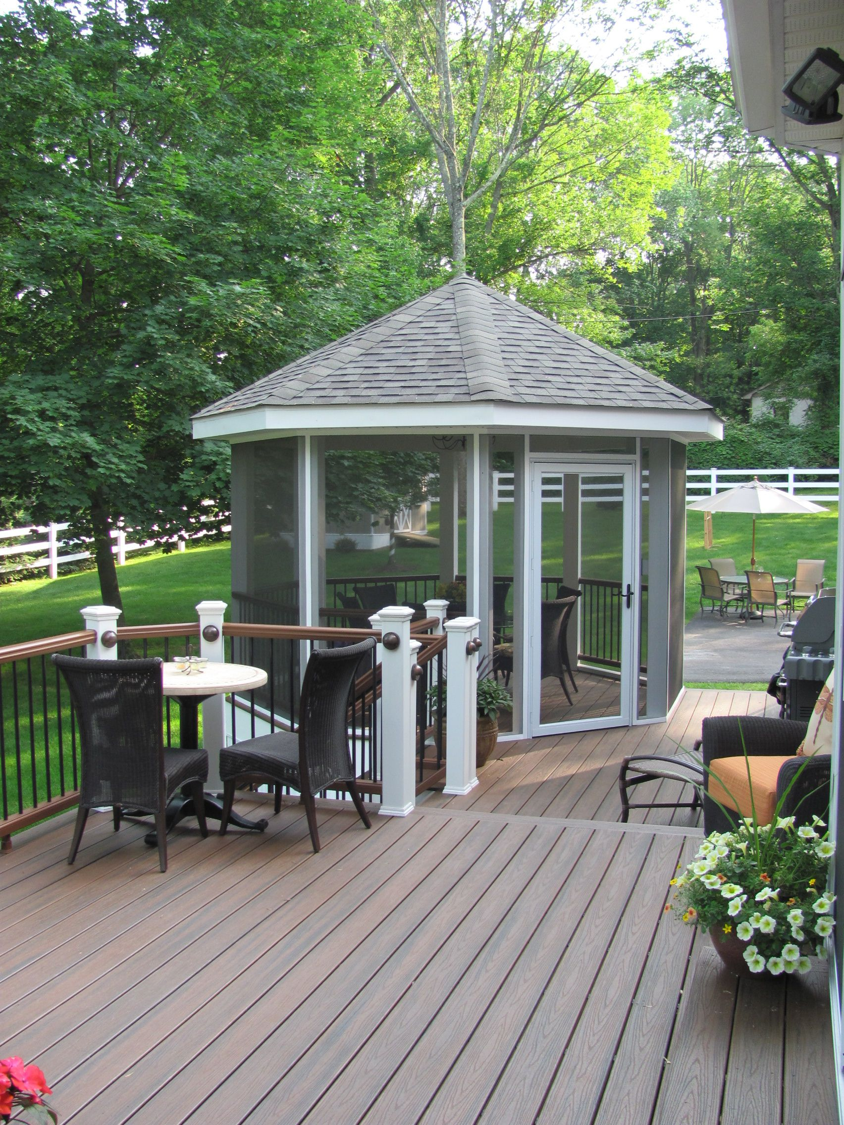 Multi tiered deck with screened in gazebo provides open