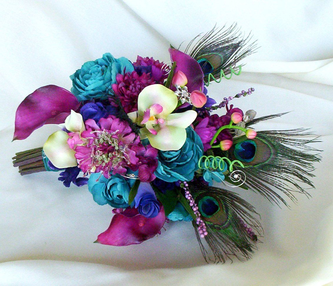 Purple and turquoise wedding dresses  flowers bouquet peacock purple teal  Wedding Inspiration