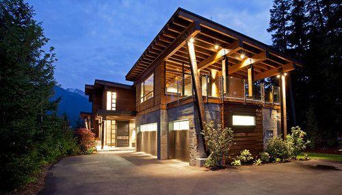 Imposante maison bois et pierre au cœur de la forêt canadienne ...