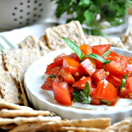 The combination of ripe tomatoes and fresh herbs on top of a creamy garlic and feta cheese base makes this Feta Bruschetta Dip great!