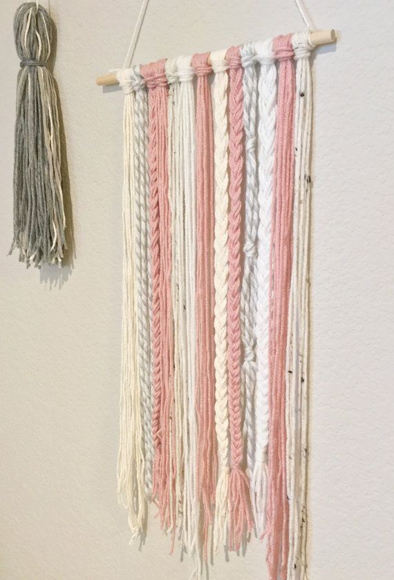 Yarn wall hanging. Woven wall hanging in dusty rose pink. Nursery girls room decor. Woven tapestry. Modern nursery. #diyyarnholder