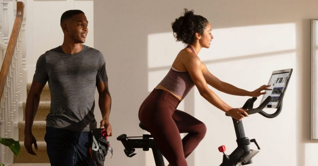 Which Peloton Should You Buy We Break Down The Pros And Cons Of Peloton S Full Product Suite So You Know What To Expect Stationary Bikes Peloton Peloton Cycle