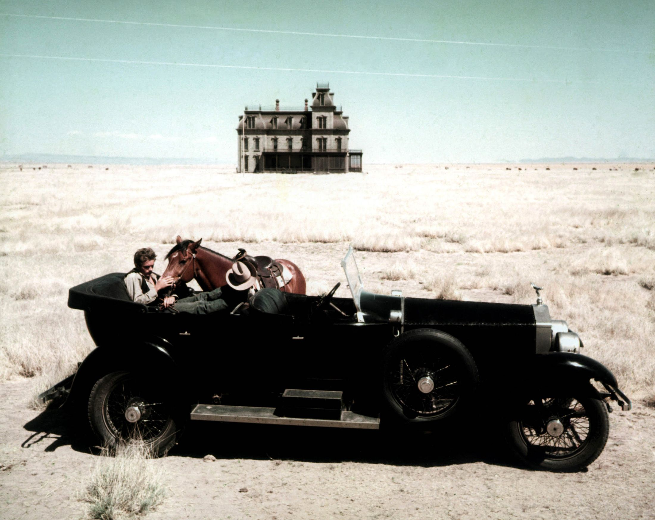 James Dean in a classic car and alongside  with his horse (1956 Giant)