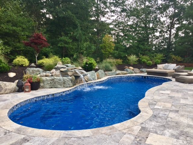 We Love It Those Are The Words Of The Coyne Family On Achieving Their Life Of Leisure Wit Backyard Pool Landscaping Small Pool Design Backyard Pool Designs
