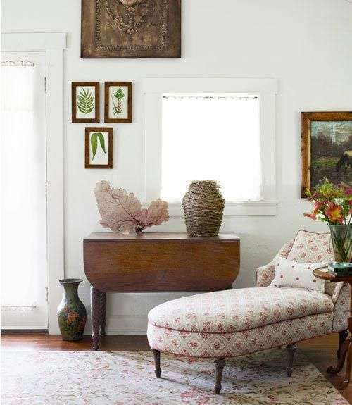 We love the three framed botanical prints in this charming sitting area. #livingrooms #homedesign #decorating