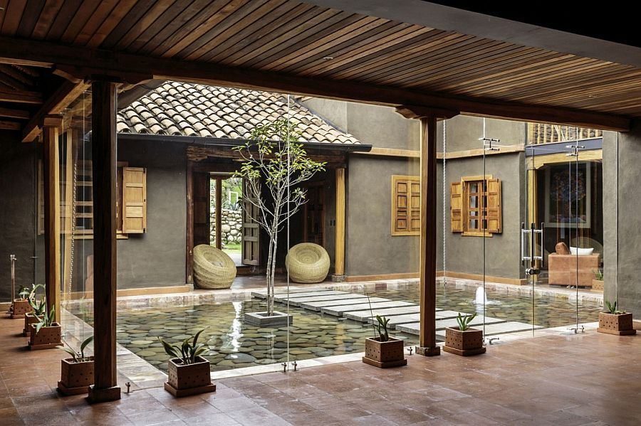 central courtyard of the home with a reflective pond and