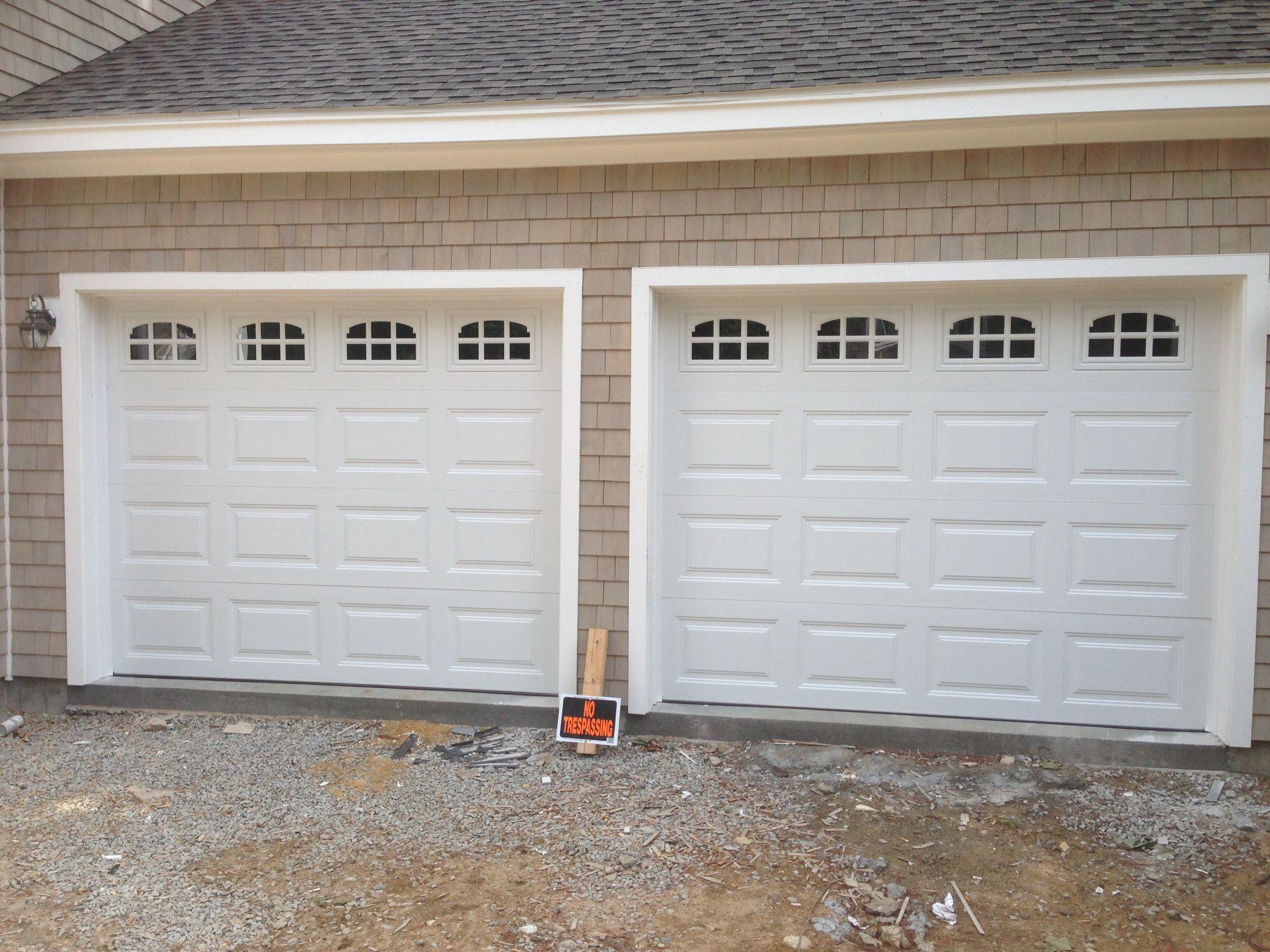 Haas model 680 steel raised panel garage doors in white with cascade glass installed by - Garage door window panels ...