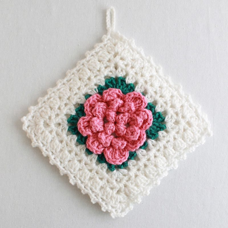 Looks like a vintage crochet pot holder and the patterns is FREE ...