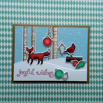 "A joyful Christmas card, using the Joy to the Woods"" stamps from ""Lawn Fawn""."