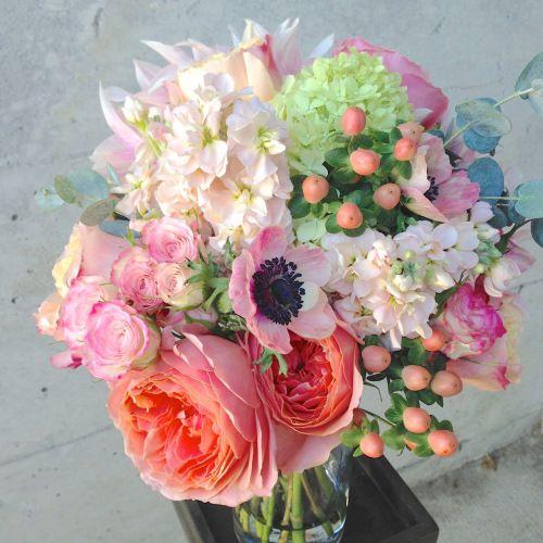 Christopher Flowers, Seattle. Bridesmaid bouquet, coral, peach, green. Garden rose, dahlia, anemone, hydrangea, hypericum.