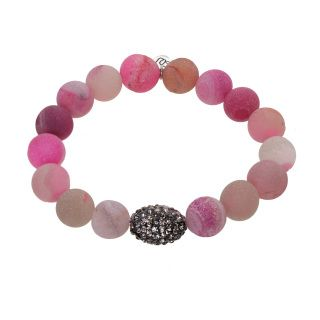 The Pink Druzy Stone beaded bracelet is accented by a pave oval bead. The beads have an overall pink hue with grey and beige swirls. The matte surface has a sandy appearance with openings revealing the glittery gemstone. Strung on elastic so one size fits all.