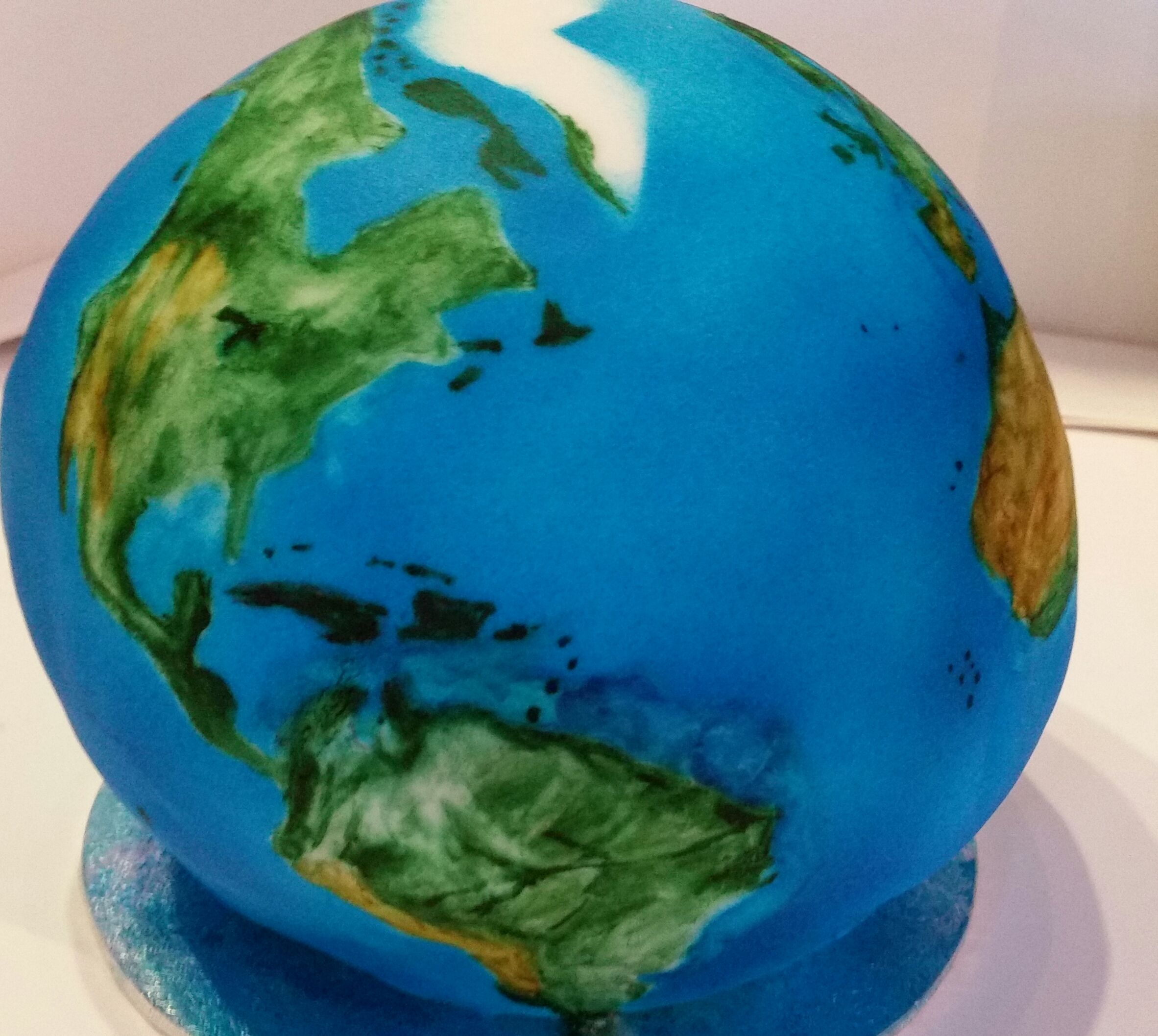 Earth cake. Airbrushed and painted with edible colours