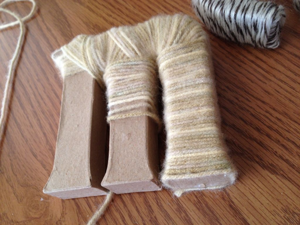 wrap paper mache letters with yarn