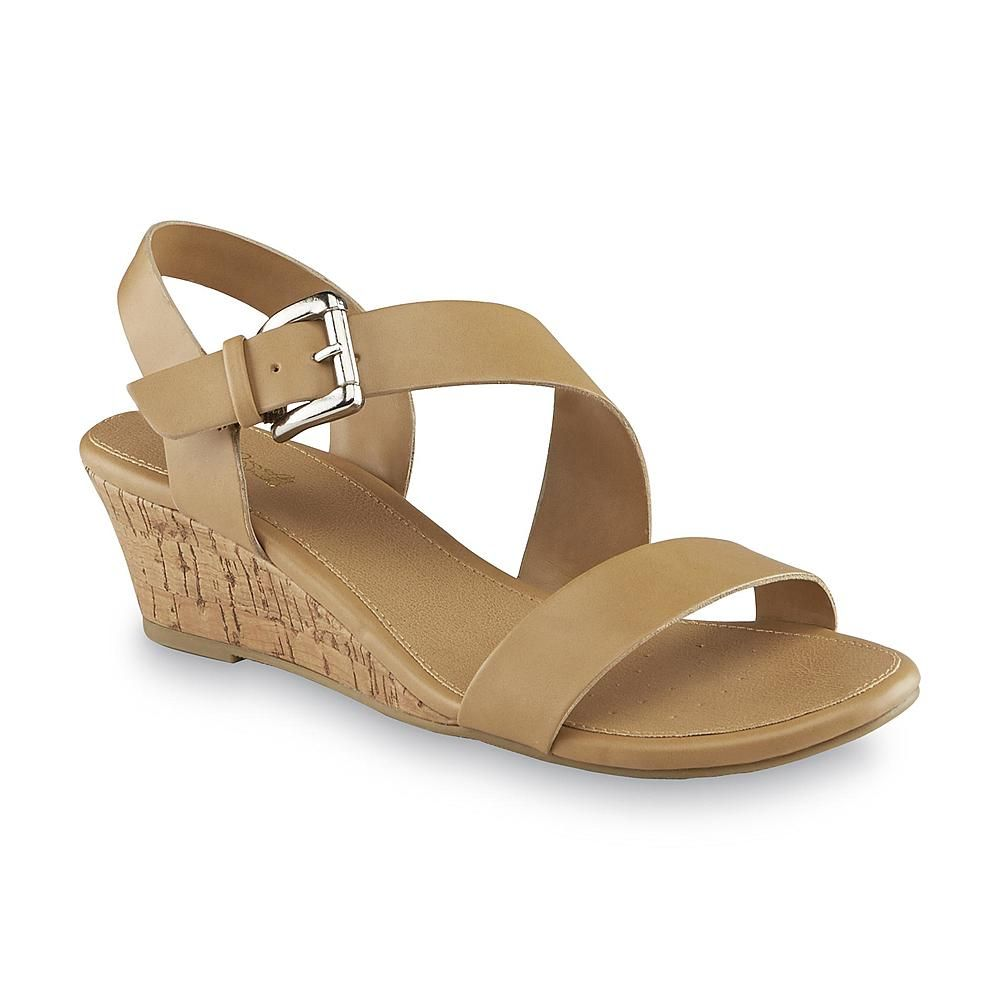 3a5e4a88143 Sweeten your step in these women s Adrian wedge sandals by Jaclyn Smith. A  strappy tan