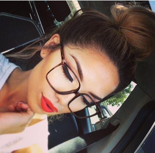 Red lip, winged liner, glasses, bun