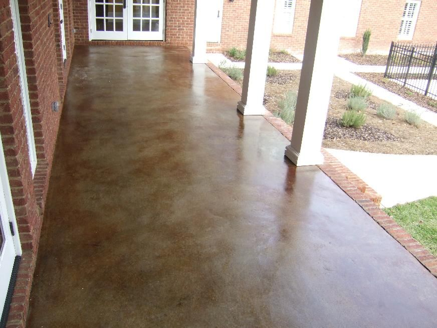 7 Ways To Add Character To A Concrete Porch Our Storied Home Concrete Stain Patio Concrete Patio Stained Concrete Porch