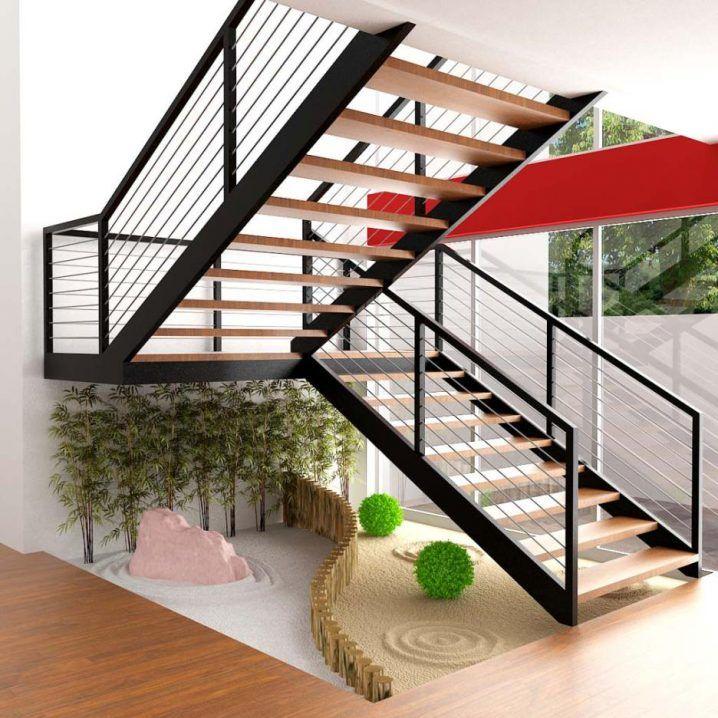 ideas decorar bajo la escalera con guijarros y plantas