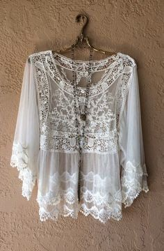 3afb26df235029 Beautiful lace blouse 2 colour White and Off white Fabric is stretchable.  Measurements, Bust 36 inches stretch up to 42 inches. Length 22.5 inches  Sleeve ...