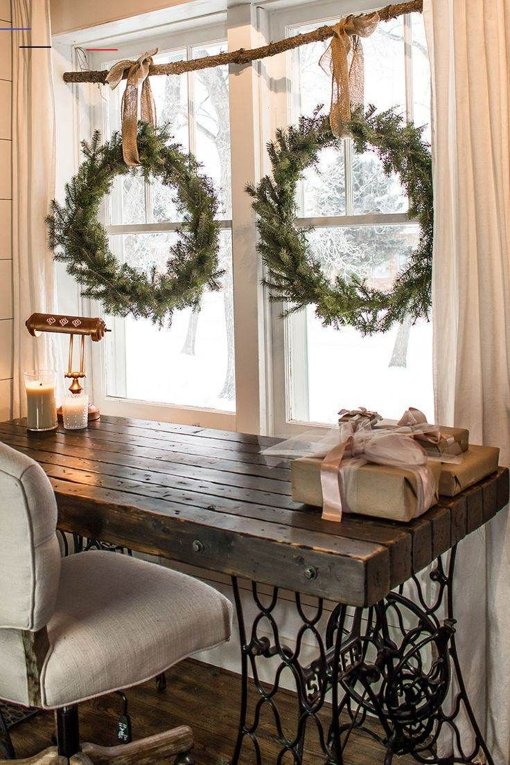 DIY Wreaths for the Holidays that Won't Cost you a Cent. Make these DIY wreaths for FREE  without buying a wreath form.  Make your own holiday decorations with a few pine tips and hedge branches.  This easy craft tutorial will show you how to make these Christmas wreaths and build a rustic window display all without spending a cent! #littleyellowwheelbarrow #wreaths #freecrafts #homedecor #decor #christmas #diy<br> DIY wreaths you can make for FREE without having to buy a wreath form or any expe