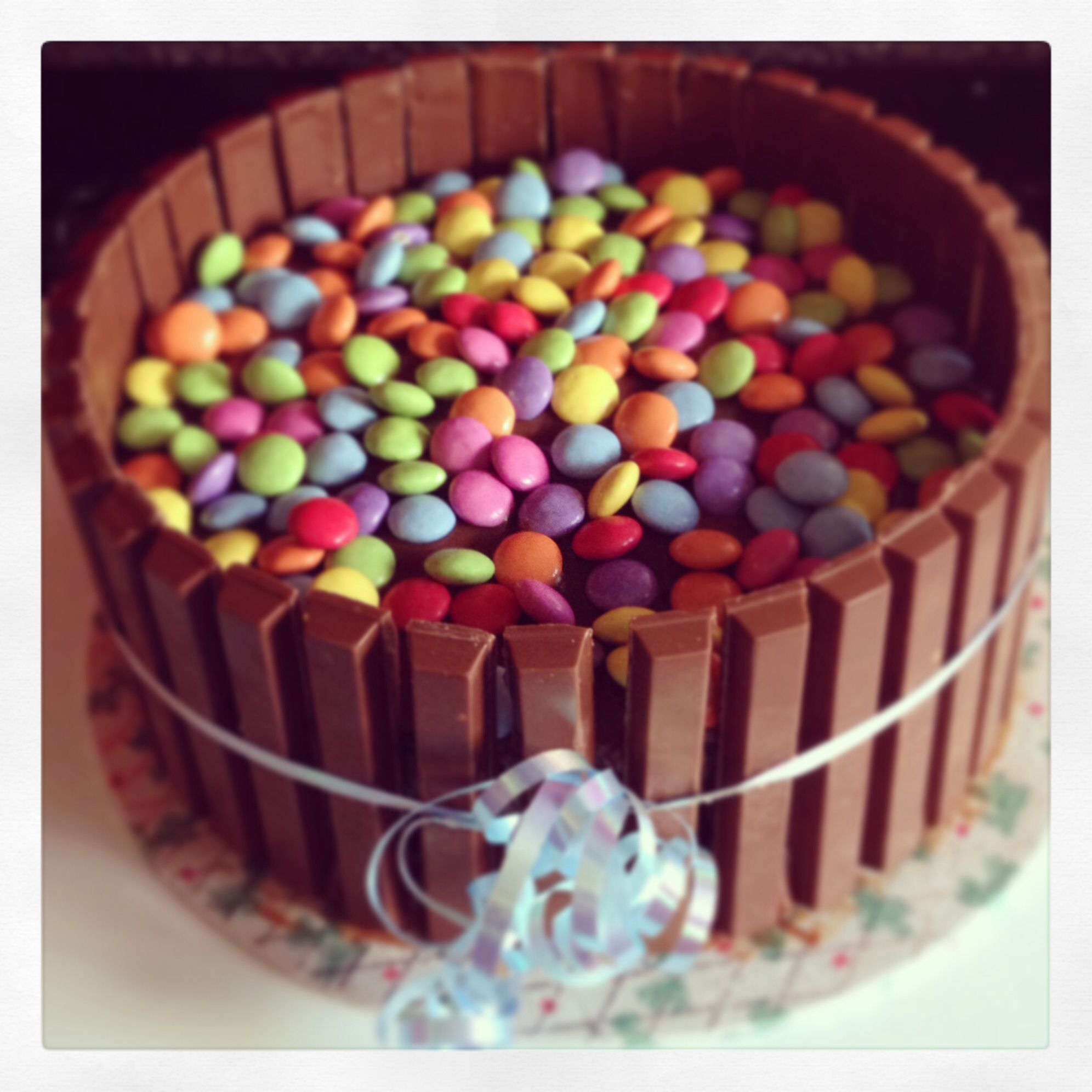 Birthday cake Chocolate cake topped with smarties and surrounded by