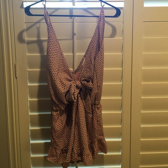 Love culture romper Nude/pinkish color with black floral pattern. Never worn! Love Culture Other