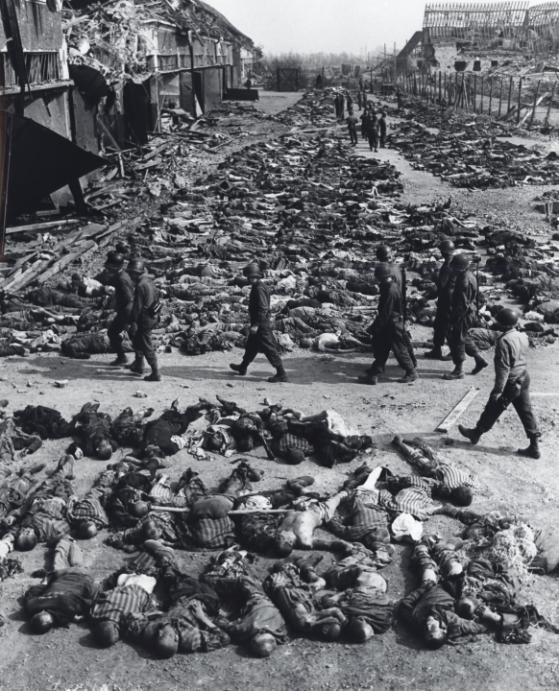 The bodies of almost 3,000 slave laborers are laid out along a bombed street before burial by U.S. troops, Nordhausen, Germany, April 12, 1945. (Photograph by John Florea courtesy Steven Kasher Gallery, New York)