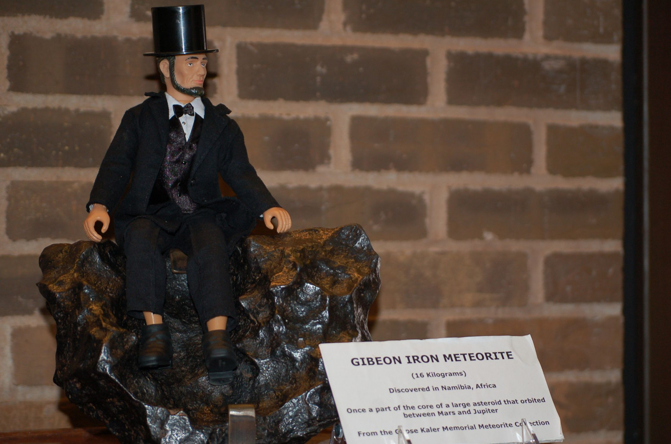 Mini Abe thinks this meteorite makes a great chair at