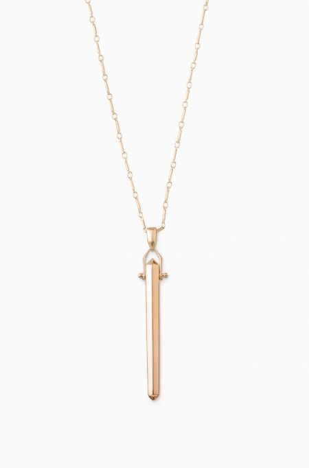 Turn heads in the prism swinging from this rose gold pendant