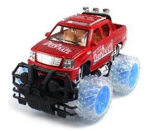 """Conqueror Cadillac Escalade EXT Electric RC Truck 1:16 RTR w/ Light Up Wheels(Colors May Vary) Monster Truck Style by Velocity Toys. $36.95. Requires 400mAh 4.8V Battery to run (Included)  Remote Control requires 9V Battery to run (Included). Features:  Electric Powered (Rechargeable)  Full Function! (Go Forward and Backward, Turn Left and Right). Length: 10.5""""  Width: 6.5""""  Height: 6"""". 1:16 Scale  Adjustable Front Wheel Alignment  High Gloss Paint Job. Front and R..."""