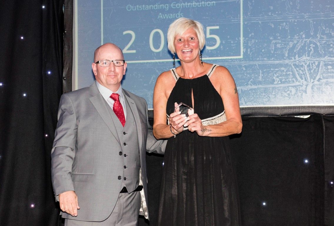 Our category sponsor presents Jakki Kent with her Contribution to the Community award!