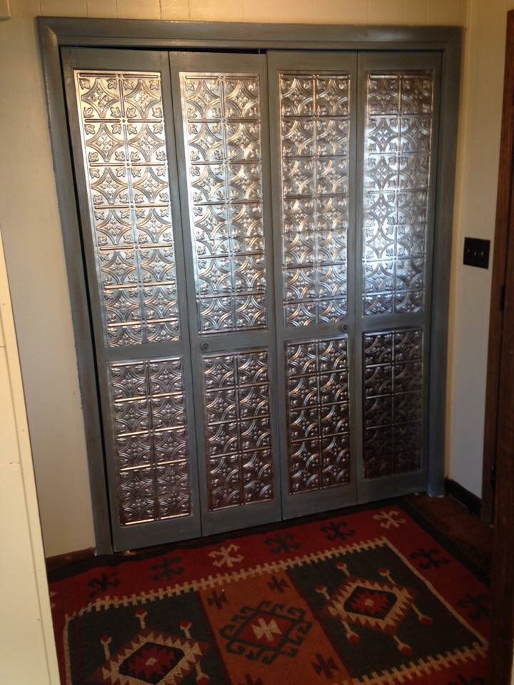 Do You Have Unattractive Louver Doors Try This Update Using Tin Panels Now It Will Be Cheaper To G Diy Closet Doors Bifold Doors Makeover Glass Closet Doors