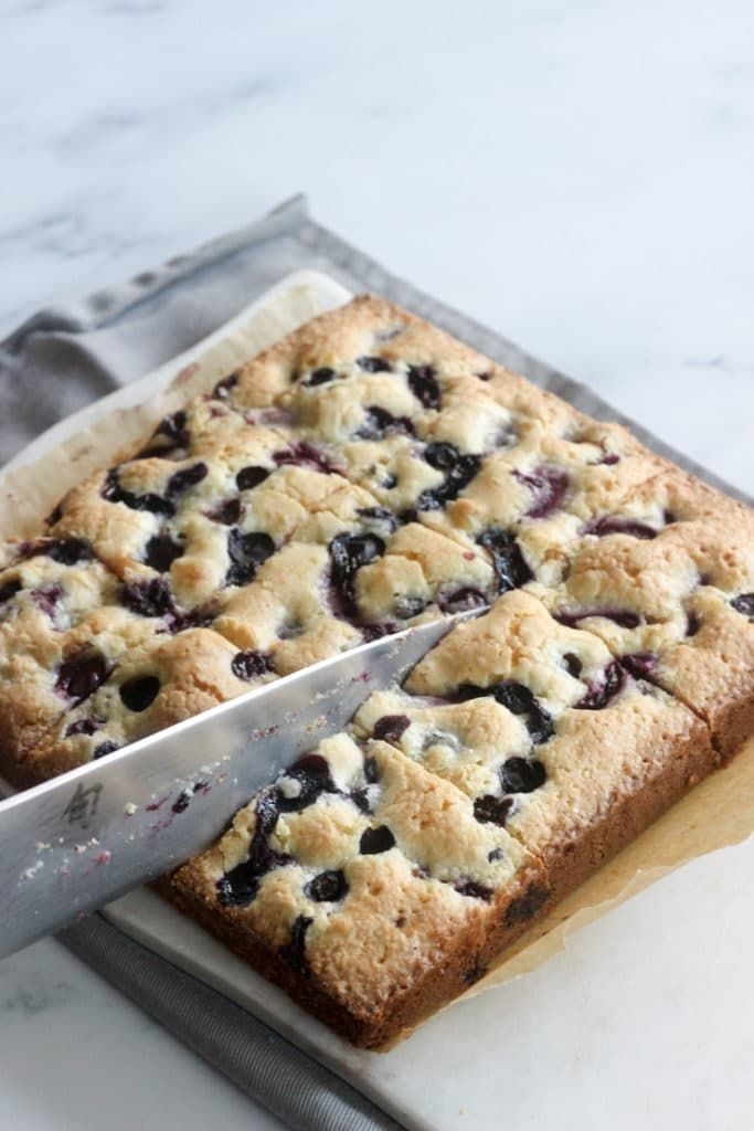 Fresh Blueberry & Cherry Cake Bars Recipe (Sip Bite Go) Chewy fresh blueberry and cherry cake bars. One of the most popular summer desserts for parties. An easy summer desserts with few ingredients, including fresh or frozen berries. They taste like a blondie dessert bar. Try this tasty cherry and blueberry dessert recipes. |