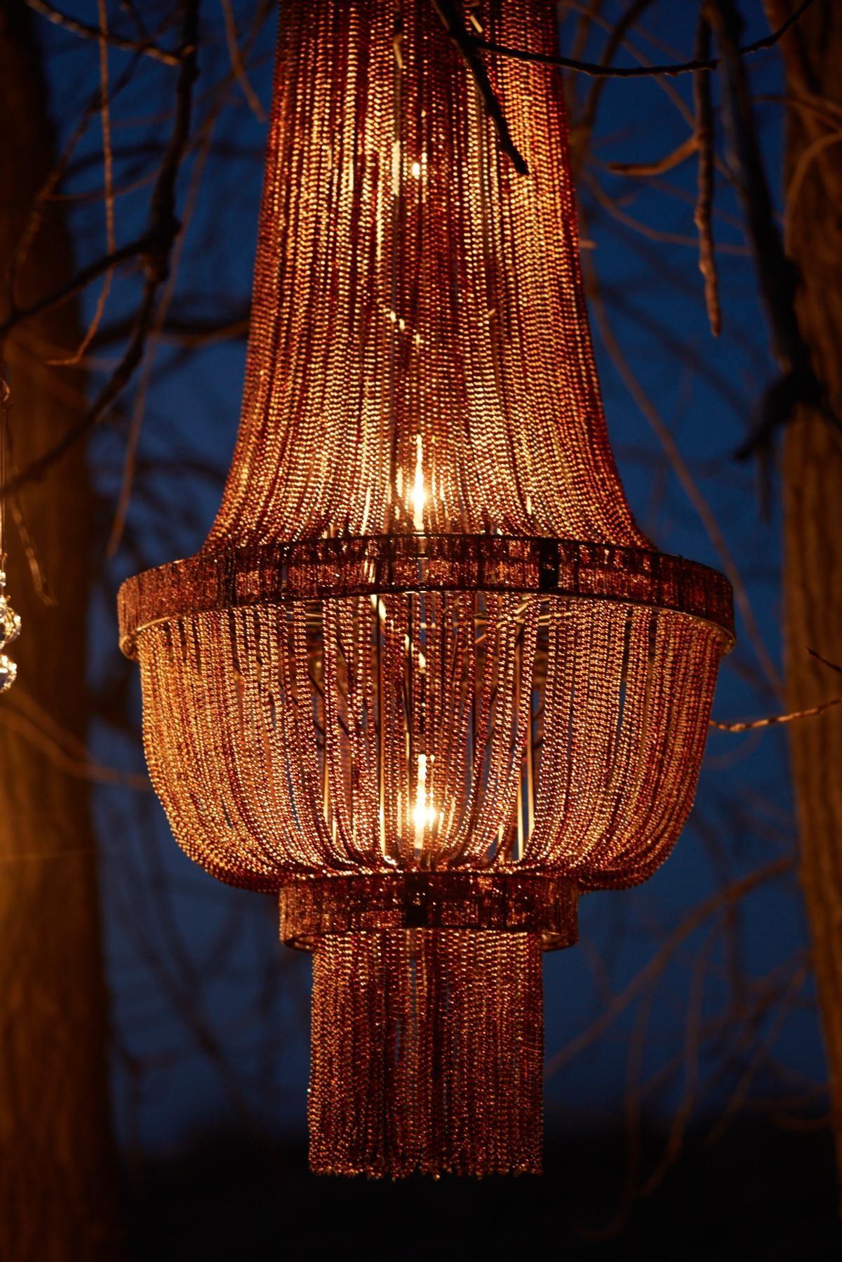 The Pluie aubergine chandelier all lit up Arhaus