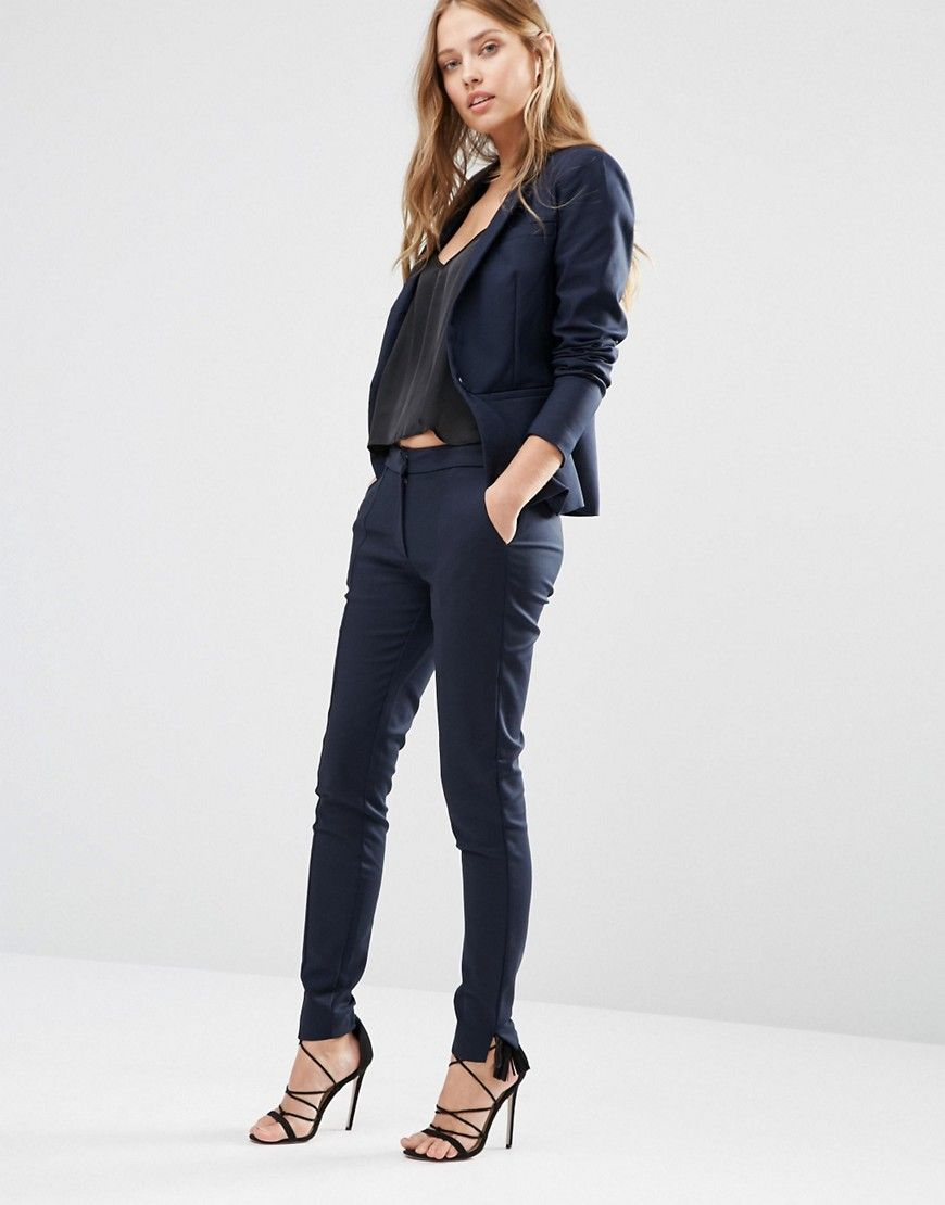 Navy pant suit with a black cami for a sleek winter work outfit
