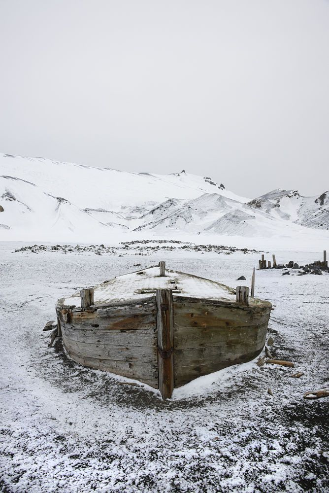A wooden boat hull beached on Deception island, a former whaling station. by Mint Images on 500px