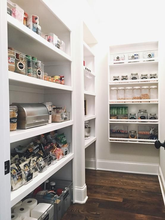 Amazing Pantry Features Large Black Labeled Bins Filled