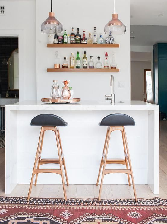 White marble waterfall bar with floating wooden shelves + low back ...