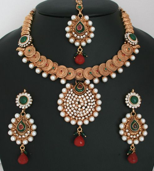 Beautiful White polkistones and Imitation Pearls Design Polki Gold Plated Jewellery Set-011PLKJ57  http://www.craftandjewel.com/servlet/the-1722/Beautiful-White-polkistones-and/Detail