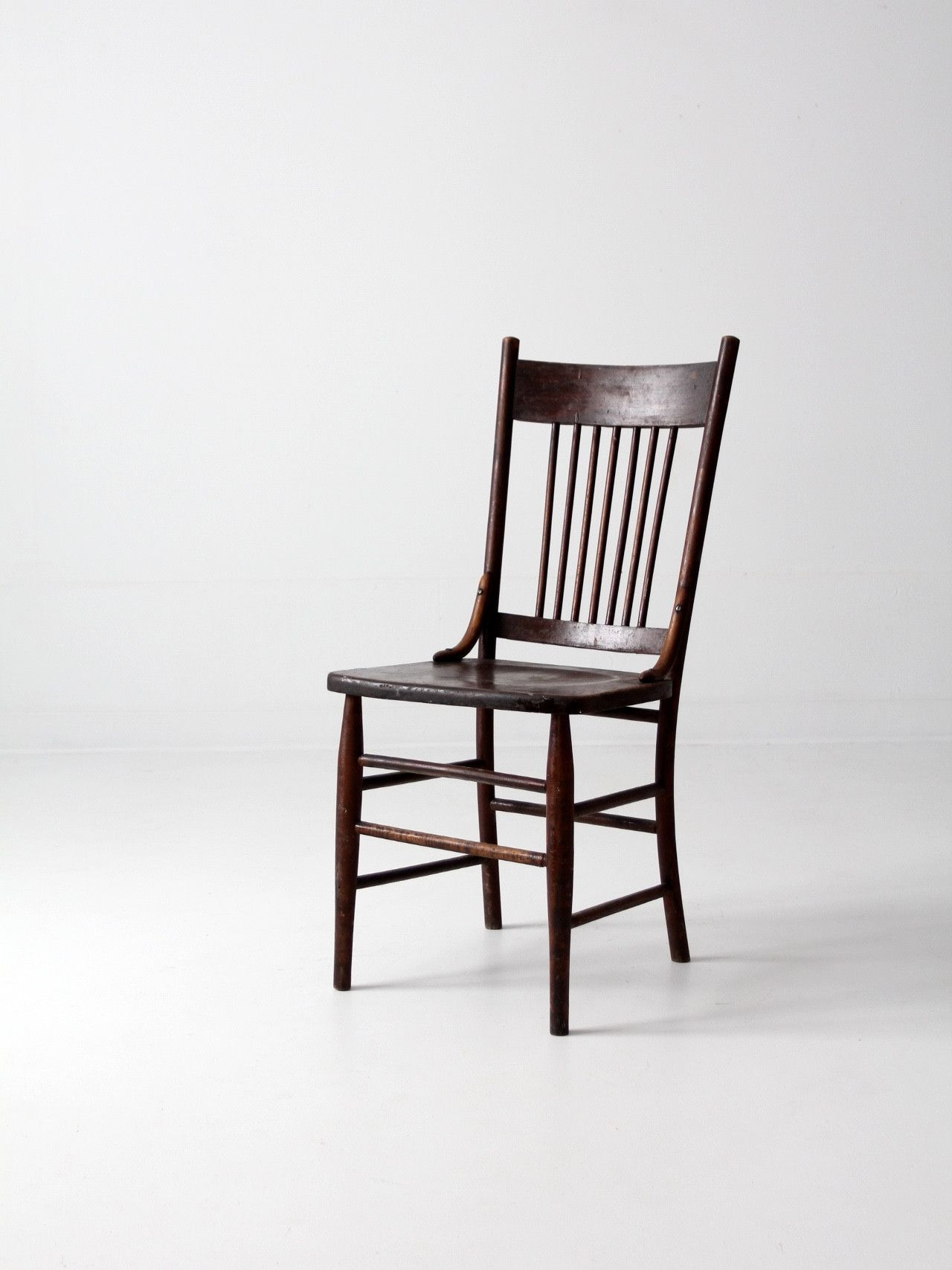 An Antique Spindle Back Chair The Wood Dining Chair Features Simple Sleek Lines With A Dark Tone Stain It Has Slen Chair Wood Dining Chairs Farmhouse Chairs