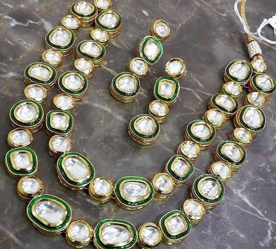 Gorgeous 2 ladi kundan necklace set. uncut kundan lined with green meena . This is set in a silver alloy with gold plating. Please contact me before buying if you have a time constraint.