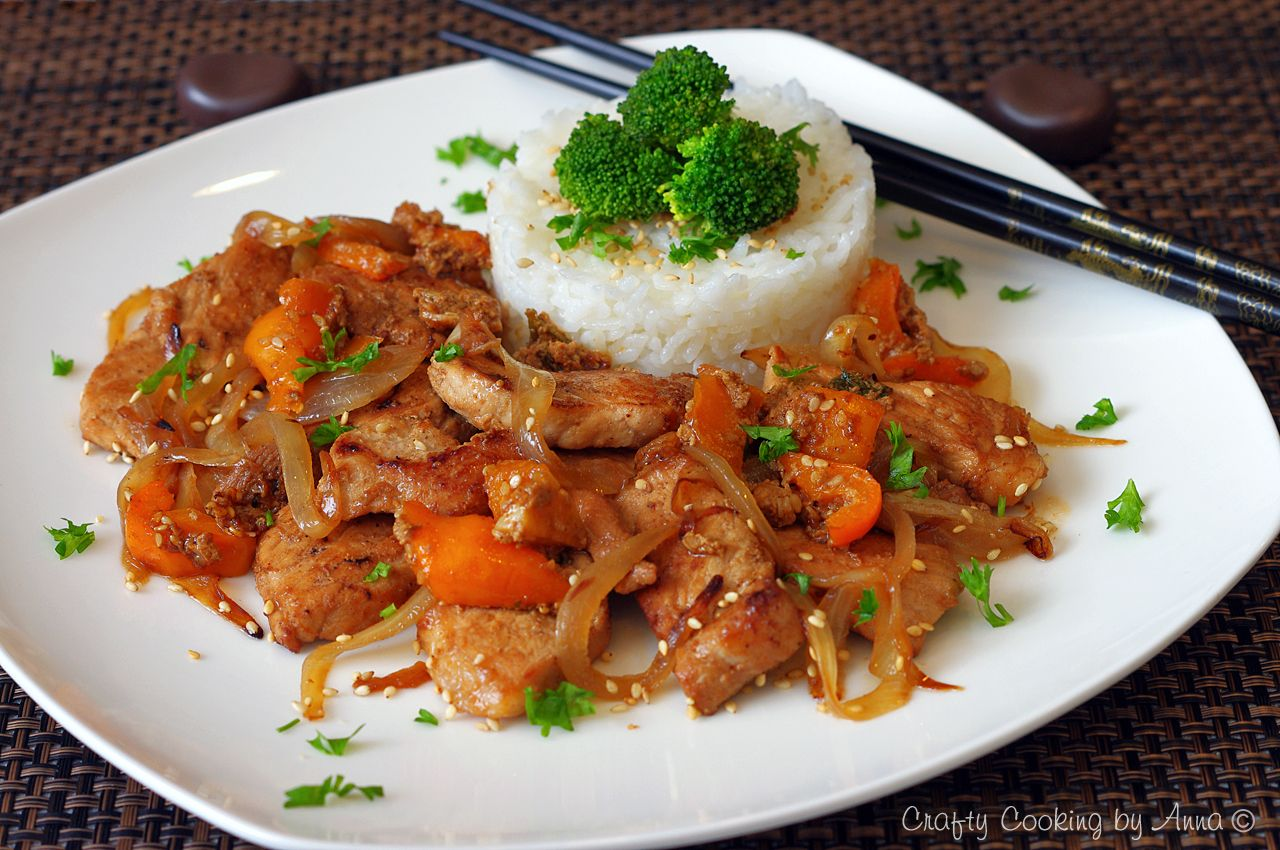Marinated Teriyaki Pork with sautéed onions and peppers in Sesame Oil. Served with Sushi rice!