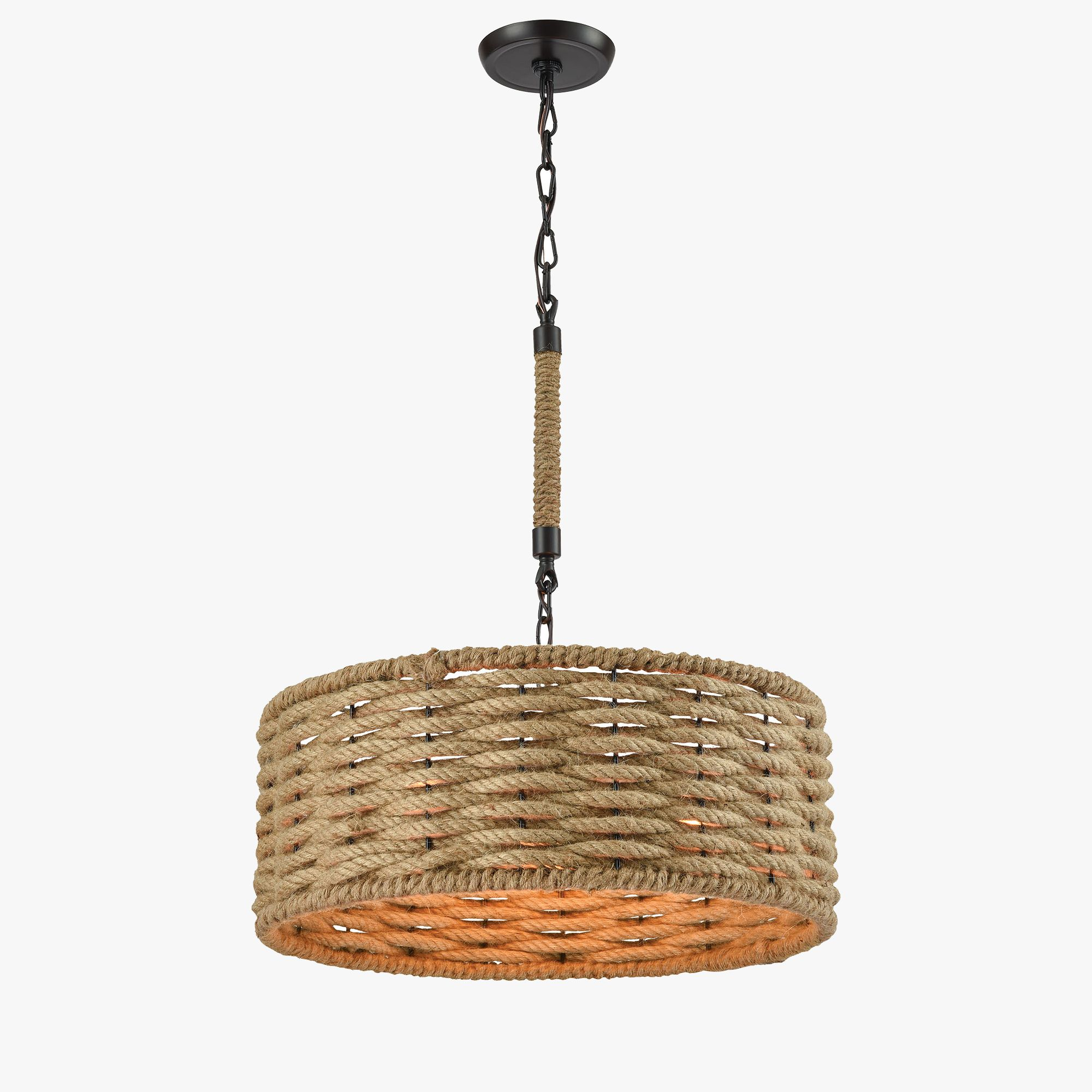 An intricate rope-woven drum chandelier with oil rubbed bronze finishes provides the perfect coastal style to any space.