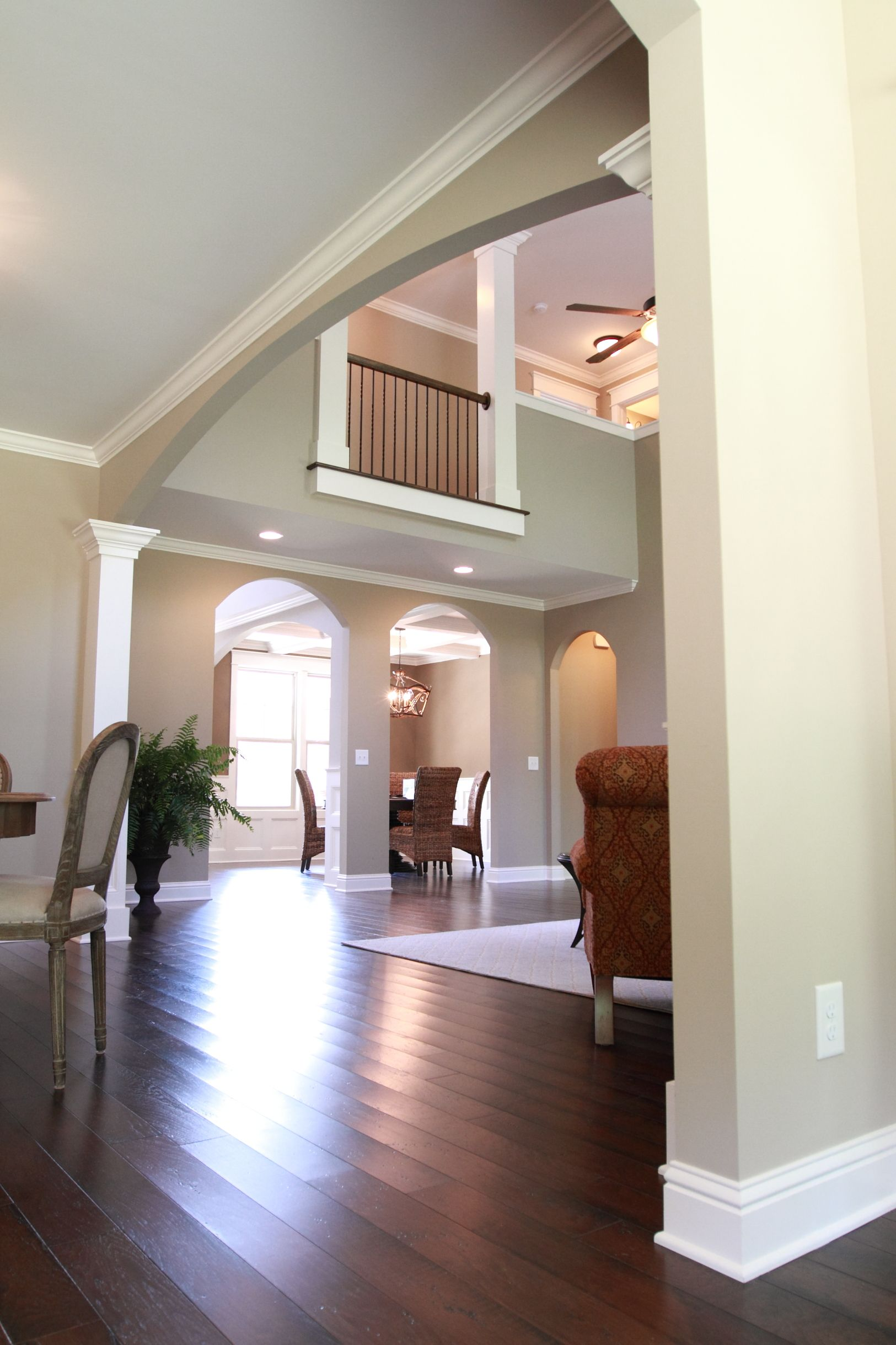 wood floors and two-story ceiling in the living room