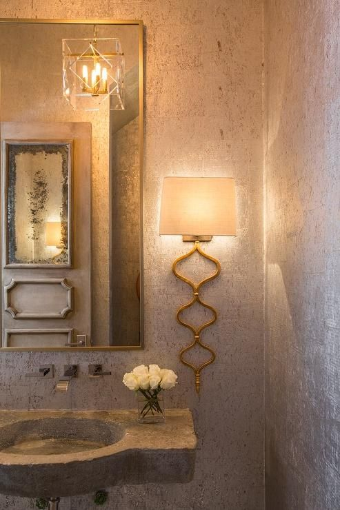 Mediterranean Powder Room Features Silver And Gold Metallic Wallpaper On Walls Lined With A Rectangular Br Mirror Wall Mount Modern Faucet Laced