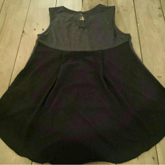 Coffe & Cake Hi Low Mixed Fabric Tank Charcoal knit front and top back yoke with black chiffon pleated drapey back body.  Keyhole neck with button.  IMO can fit a smaller sz med as well as small. Coffee & Cake Tops