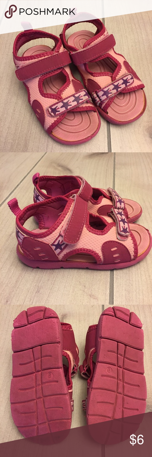 Pink Sandals Girls pink sandals. These are listed in play condition because they got a lot of camping/play wear, not because anything is wrong with them. Lots of life left. Great for water shoes. I don't know the brand but toddler size 9. 1/10/S Shoes Sandals & Flip Flops