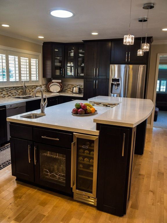 An Oddly Shaped Kitchen Island: Modern Kitchen With Wine Refrigerator, Flat Panel Cabinets