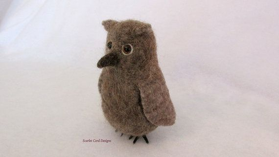 This is a sweet fuzzy needle felted brown wool owl. I usually make my needle felted sculptures very firm but this owl is a much softer felting
