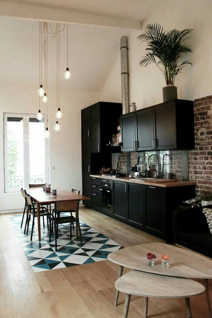 Black kitchen, loft features. Lovely inlaid tile in the hardwood