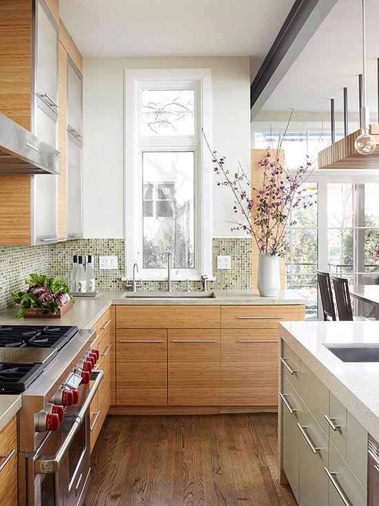 A tall, narrow window above the kitchen sink offers views of the ...